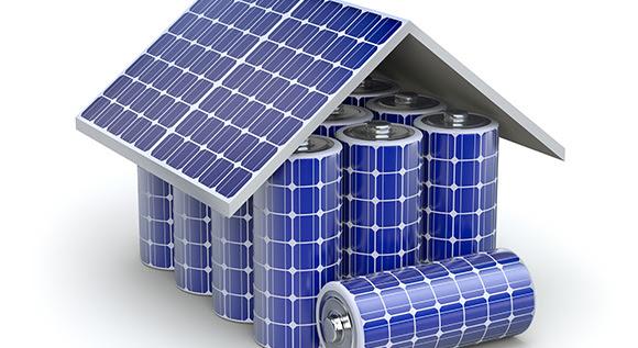 Illustration: Ein Haus zusammengesetzt aus Solarzellen und Batterien.