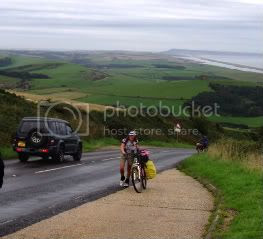 cyclists,sea,fields,road,cars