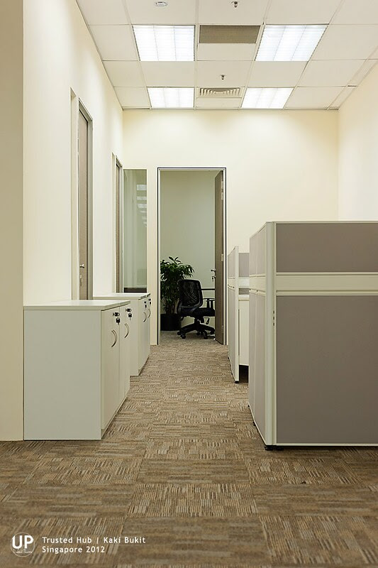 Corridor to manager room passing by secretary high panel workstation