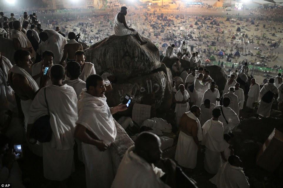 Taking in the view: Huge numbers were up and about before first light ahead of a day of prayer on the Plain of Arafat - nine miles from Mecca