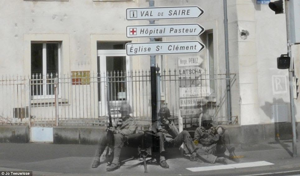 Moving moment: Servicemen rest beside signs pointing the way to a hospital and a church, with more old-fashioned script just visible behind