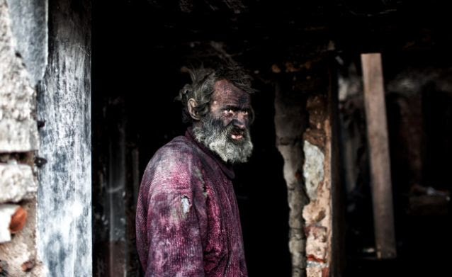 Europe's dirtiest man Ludvik Dolezal who lives in a hovel spends his nights in buried in hot ash