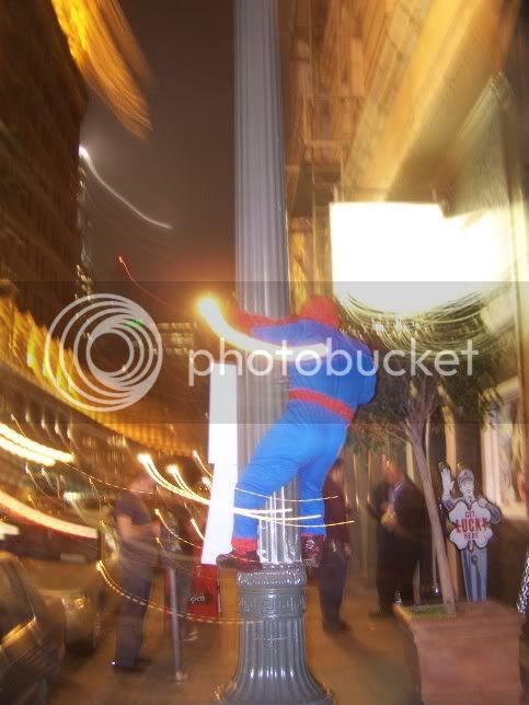 Spiderman Midget climbs light pole
