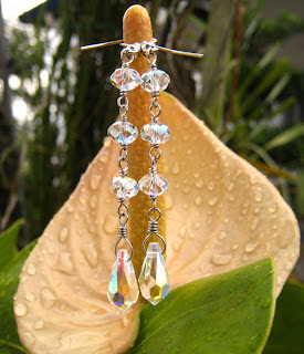 swarovski crystals wire wrapped into dangle earrings