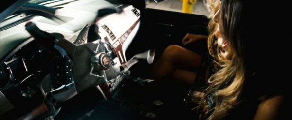 The socialite gets her comeuppance when Steering Wheel Bot attacks her in TRANSFORMERS.