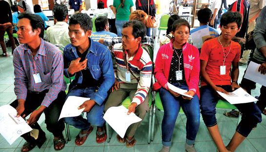Cambodian migrant workers wait their turn at one of the fast-track employment visa centres on the Thai border