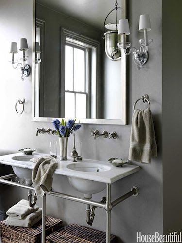 "Washstand With Towel Bars ""I love this washstand from Waterworks, because I can hang wet towels without having to have towel bars everywhere,"" designer Barry Dixon says of the bathroom in a Washington, D.C. row house. Undermount basins and Etoile fixtures from Waterworks. Sconces by Crowder. Urban Smokebell lantern by Baker."