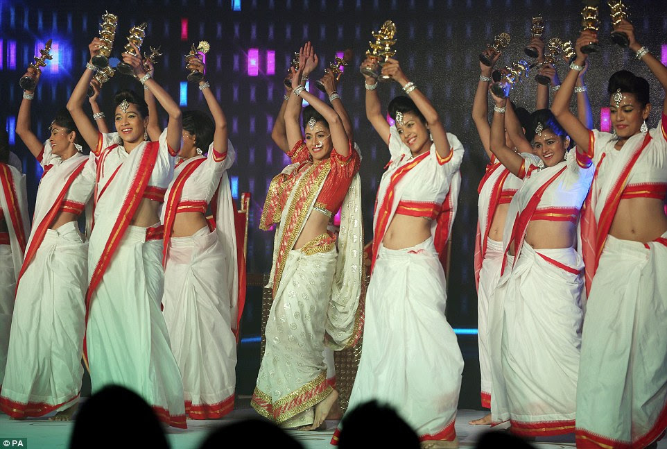 The energetic performers, dressed in sparkling and revealing outfits, sprung across the stage as the audience whooped and clapped