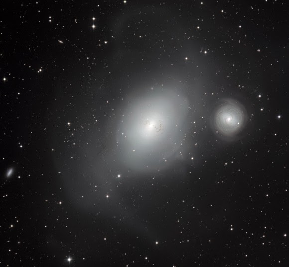NGC 1316 (left) and its smaller companion galaxy NGC 1317. Image taken with the MPG/ESO 2.2-metre telescope at ESO's La Silla Observatory in Chile. Credit: ESO