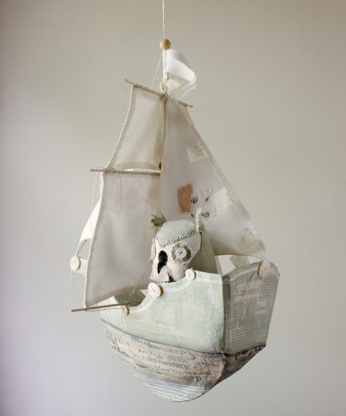 paper mache ship and owl