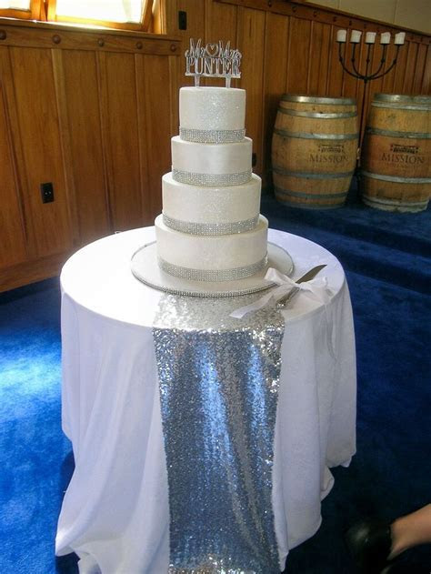 Four tier wedding cake with shimmering glitter effect and