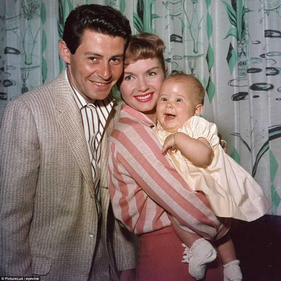 While Fisher's mother (center, holding Carrie as a child in 1957) is still alive, her father, Eddie (left) died in 2010