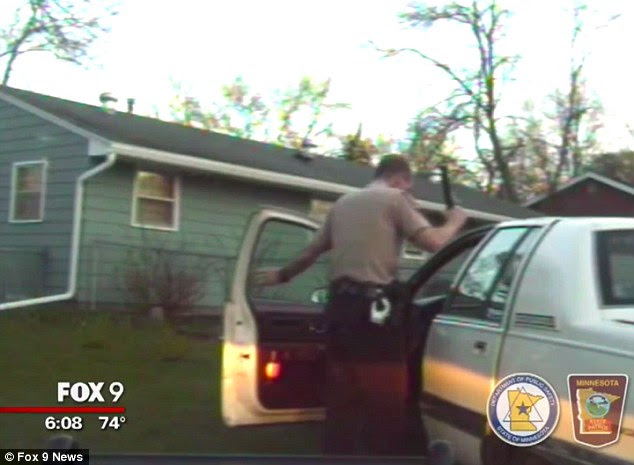 Sprung: This is the moment trooper Kyle Klawiter opens the car door to talk to the little boy behind the wheel, who had been driving for about 15 miles with his young siblings in tow, authorities say