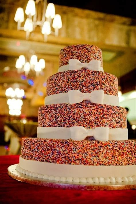 My perfect NYE wedding cake covered in rainbow sprinkles