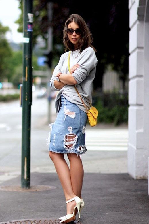 Le Fashion Blog 7 Ways To Style A Distressed Denim Skirt Blogger A Portable Package Sunglasses Grey Gray Sweater Slouchy Sweatshirt Tan Round Watch Yellow Mini Crossbody Bag with Chain Strap White Ankle Strap Heels Pumps Ripped Jean Skirt 1 photo Le-Fashion-Blog-7-Ways-To-Style-A-Distressed-Denim-Skirt-Blogger-A-Portable-Package-1.jpg