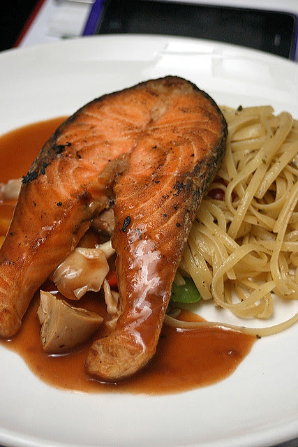 Maple mustard salmon steak with linguini in homemade pesto