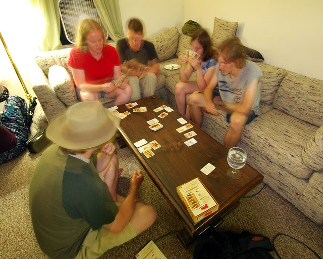 People playing a card game.