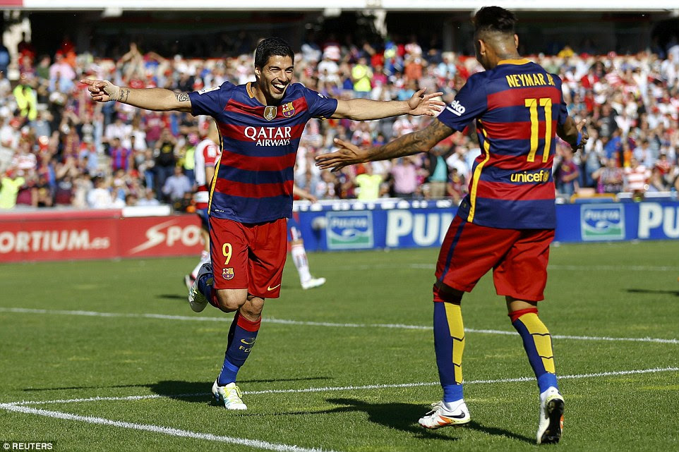 Luis Suarez celebrates with team-mate Neymar after completing his hat-trick as Barcelona romped to a 24th league title on Saturday