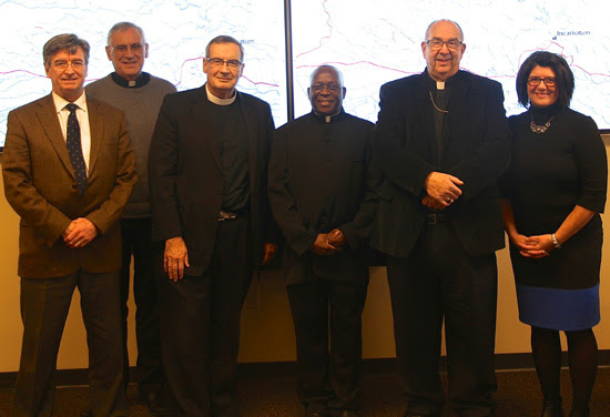 From left: Michael Marshall, chair of the Crozet Mass Committee; Vicar General Msgr. Mark Lane; Judicial Vicar Msgr. Raymond Francis Muench; Holy Comforter Catholic Church pastor Fr. Joseph Mary Lukyamuzi; Bishop Francis X. DiLorenzo; and Crozet Mass Coordinator Julie Balik.