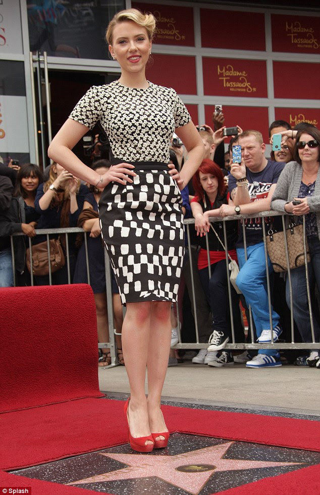 Thrilled: Beaming, the blonde beauty posed for pictures with her star