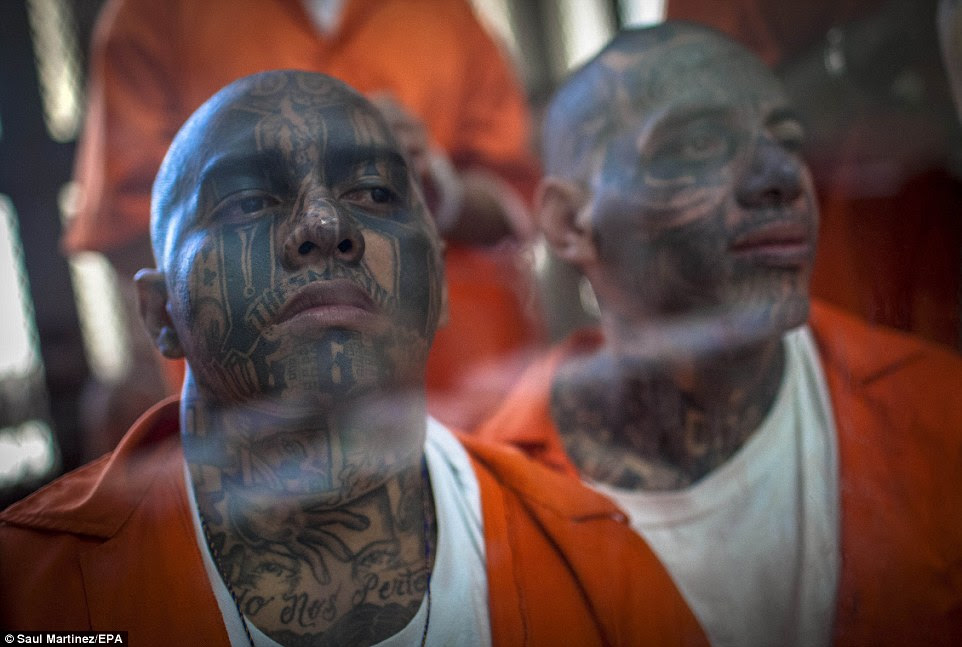 Justice: Marvin Ismael Reyes (left), aka 'The Smoking', and Jose Daniel Galindo (right), aka The Criminal', both of the Mara-18 gang, appear in court in 2013 accused of extortion and murder