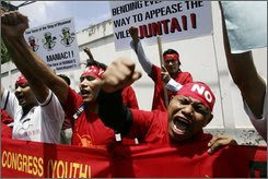 Protesters shout slogans during a rally Tuesday, May 27, 2008, outside the Myanmar embassy in Bangkok, Thailand.  Security was stepped up around detained pro-democracy leader Aung San Suu Kyi's house Tuesday as Myanmar's military junta faced a deadline to decide whether to release her or extend her house arrest for another year. (AP Photo/Sakchai Lalit)
