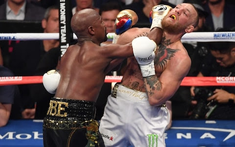 """alt=""""Round 10  And it's over. Hard concussive, accurate punches rain in from Mayweather who is hurting McGregor who stumbles across the ring and into the ropes from a right hand, off balance, and is close to going down. The attack continues. Left. Right. Left. McGregor's head is torqued across his shoulders. This is nasty dominance now and Mayweather looks the great boxer and McGregor the MMA fighter. Brilliant, valiant effort by McGregor. After two lefts on the ropes, referee Robert Byrd has seen enough, protects McG and waves it off."""""""