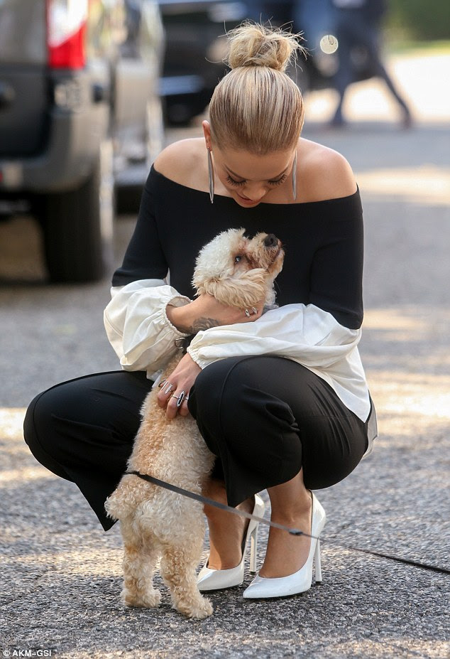 Best of friends: Rita couldn't bear to tear herself apart from the adorable pet