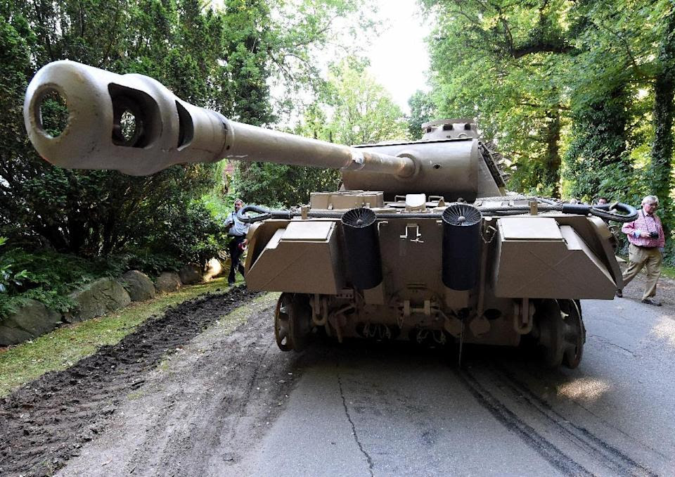 In this July 2, 2015 picture a  World War II  era Panther  tank  is prepared  for transportation from a residential property in Heikendorf,  northern ...