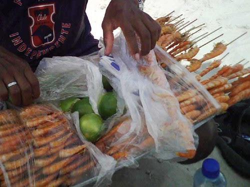 Selling camarones on the beach