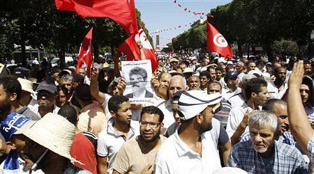 Tunisians protest after Mohamed Brahmi's assassination. Two days of demonstrations have called for the resignation of the Islamist government. by Pan-African News Wire File Photos