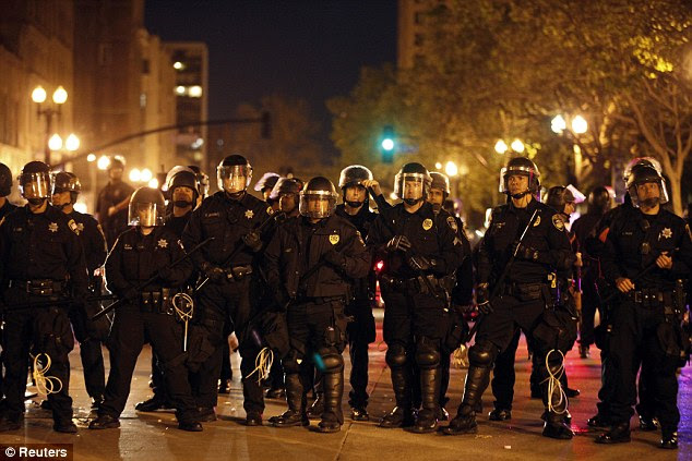 At the ready: Police officers form a line during a May Day protest in Oakland, California