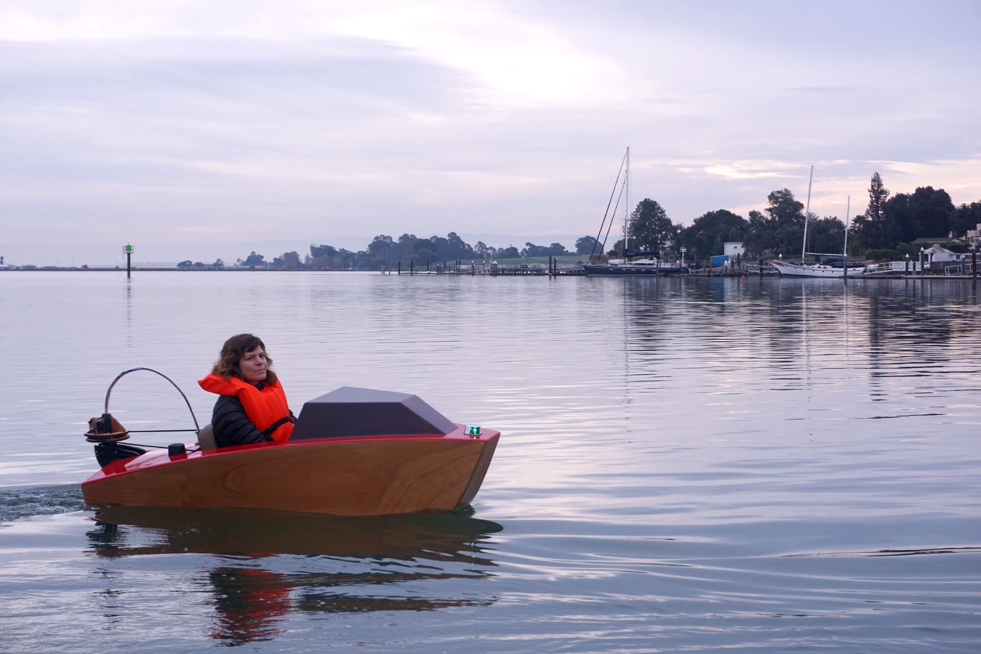 Erika at the first launch of the mini electric boat, turning around