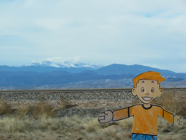 Stan with Mountains and Railroad Tracks