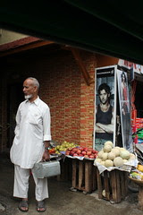 The Street Barber And The Fruit of the Loom by firoze shakir photographerno1
