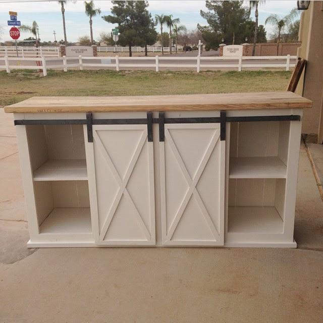 http://www.ana-white.com/2015/08/free_plans/grandy-sliding-door-console