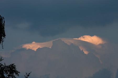 sky paintings light peeking behind clouds before the storm