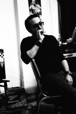 Tom takes a cigarrette