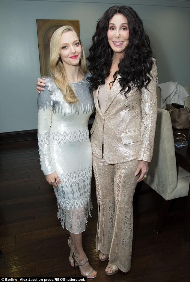 Joining forces: Cher posed up a storm with Mamma Mia! star Amanda Seyfried behind the scenes at the event