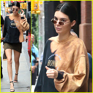 Kendall Jenner Flaunts Her Long Legs in Olive Green Skirt & Oversized Sweatshirt