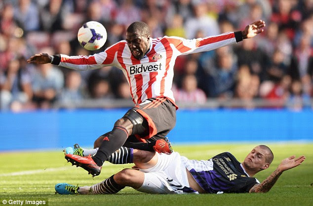 Stop there: Martin Skrtel tackles Sunderland's Jozy Altidore
