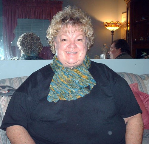 Mom wearing handpainted lace knitted clapotis scarf