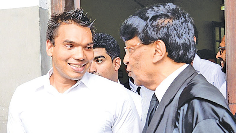 MP Namal Rajapaksa arriving at the Colombo High Court with his lawyers. Pictures by Shan Rupassara