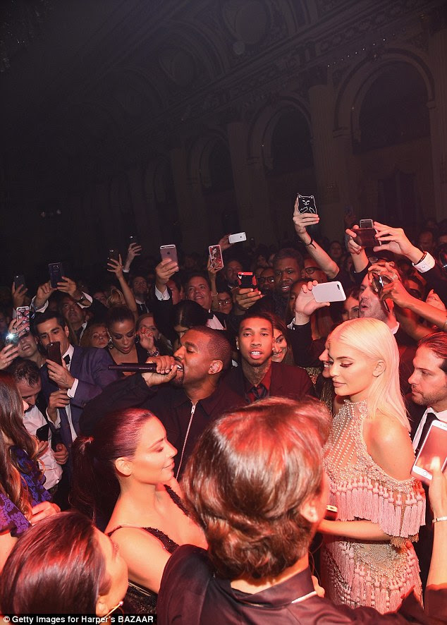 Packed house! The family was surrounded by VIPs wanting to get some snaps of Kanye