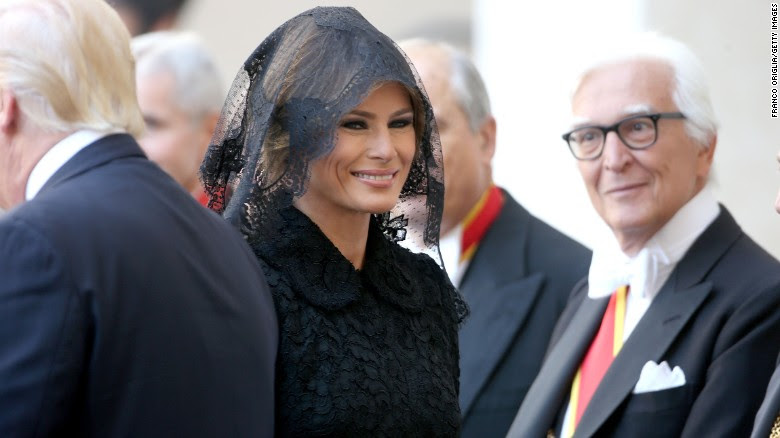 """Melania Trump, the first lady of the United States, arrives at the Vatican for a meeting with Pope Francis on Wednesday, May 24. <a href=""""http://www.cnn.com/2017/05/24/politics/melania-trump-pope-francis-headscarf-fashion/index.html"""" target=""""_blank"""">With Vatican protocol in mind,</a> she wore a black veil and long-sleeved black dress draped down to her calf."""