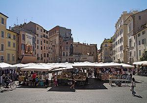 Piazza Campo dei Fiori, Rome: the market with ...