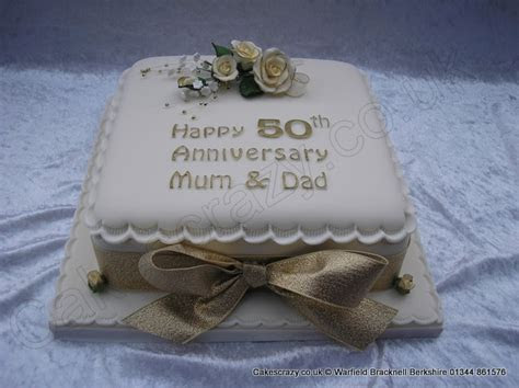 Square golden 50th wedding anniversary cake with delicate