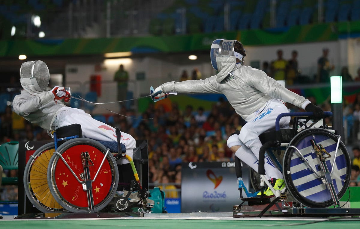 Vasileios Ntounis Greece competes with Tian Jianquan of China in fencing.