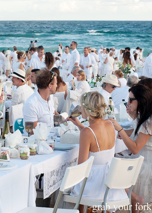Diners in white at Diner en Blanc Sydney 2013 Bondi Beach
