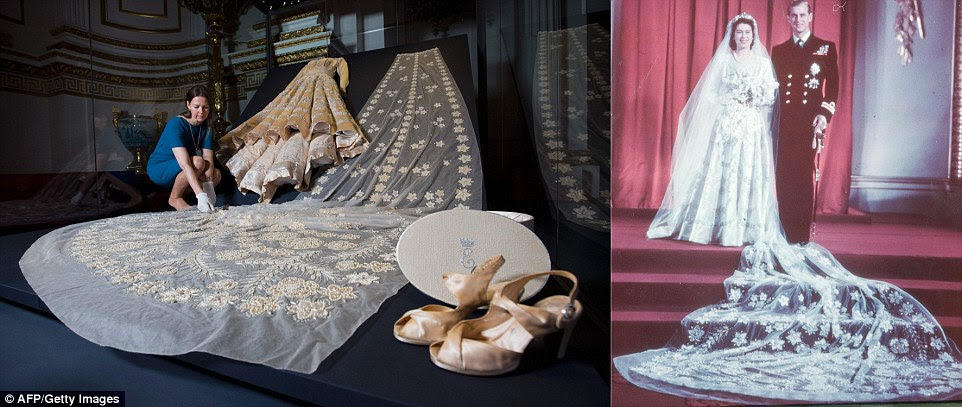 Sir Norman Hartnell's magnificent creation is in ivory silk, decorated with crystals and 10,000 seed pearls